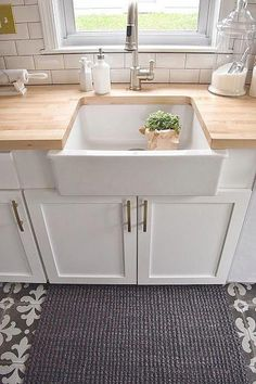 White Kitchen remodel with patterned tile and butcher block counter tops. White Kitchen remodel with patterned tile and butcher block counter tops. Farmhouse Sink Kitchen, White Kitchen Cabinets, Kitchen Wood, Country Kitchen, Kitchen White, Kitchen Sinks, Soapstone Kitchen, Condo Kitchen, Farmhouse Style