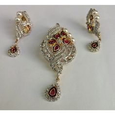 This is an Indian crafted Pendent set with embedded Perl, this set is light, eye-catching and gives a combination of royal and modern look, it goes easily with any various kinds of attires and could be used as an occasional jewelry or in daily life. http://www.indishcraft.com/default/jewellery/perl-pendent-set.html