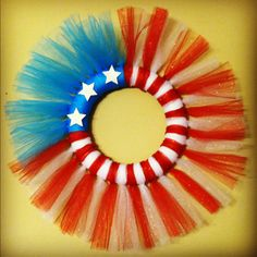 My attempt at a patriotic tulle wreath. I am pleased with the results and I'm sure be doing similar wreaths for other holidays as well.