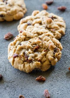 Chewy Oatmeal Raisin Cookie on a surface with raisins