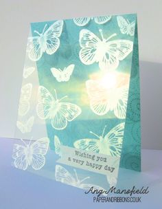 Butterflies stamped with metallic ink on a clear acetate panel allows the background color to shine through.  Handmade birthday card