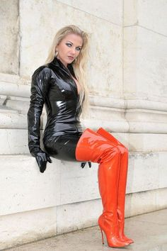 Heike teh Fetsih Queen. Black Vinyl Catsui, Gloves & red Over the Knee Boots.