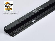 Anodized black tile trim