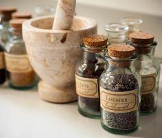 tiny glass bottles full of herbs + pestle & mortar