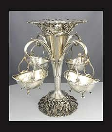american sterling epergne with hanging baskets by Roger Williams
