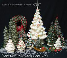 Picture of small old fashioned tabletop ceramic Christmas Trees with electric lights.