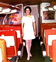Oh goodness, I worked on a plane with red and white interior and open over head bins. Times have changed!