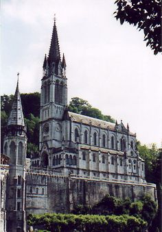 The upper Basilica at Lourdes, built directly over the grotto at Massabielle (photograph by author, June 1997)