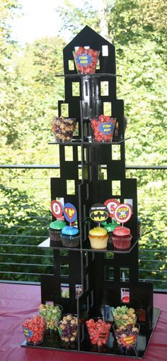 Really cute building food tower for a super hero birthday party!  We got so many compliments on this tower, now only did it add to the decor but the kids loved picking food from the top.