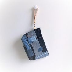This recycled denim pouch can be used as a wristlet or as a toiletry/make up bag. Its roomy enough for holding your everyday essentials like keys, wallet, phone and some more. Handmade by redstitchlab. Recycle Jeans, Upcycle, Jeans Fabric, Pouch, Wallet, Woven Bracelets, Recycled Denim, Little Bag, Zipper Bags