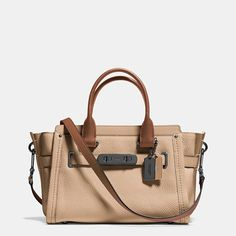 """Statement belting with double-turnlock hardware updates one of our most popular designs with a little bit of """"swagger. """"Named for a bold, brass-trimmed Bonnie Cashin design from 1967, this very modern carryall in colorblocked leather comes with three separate compartments inside and a detachable strap for crossbody wear."""