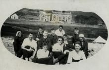 A group of Jesuits relaxing on the beach with Barmouth Villa in the background.
