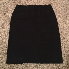 Pencil skirt Black pencil skirt! 6 decorative bottoms in front. Zipper in back. Little slip in back. Worn on a few times. Skirts Pencil