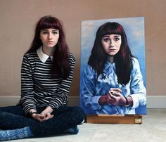 Eighteen year old artist Kate Powell with a self-portrait completed during her last year of high school
