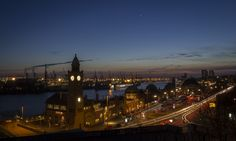 https://flic.kr/p/r8LTSA   Landungsbrücken at dusk   en: Landungsbrücken, also referred to as the St. Pauli Piers, St. Pauli Landing Stages or St. Pauli Landing Bridges, are the largest landing place in the Port of Hamburg and also a major tourist attraction.  The piers are located in the St. Pauli area of Hamburg, Germany, between the lower harbour and the Fischmarkt (Fish Market), on the banks of the Elbe river. The Landungsbrücken today form a central transportation hub, with S-Bahn…