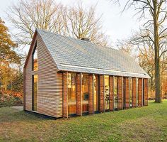 This tiny Dutch garden house was turned into a gorgeous shutter-clad getaway | Inhabitat