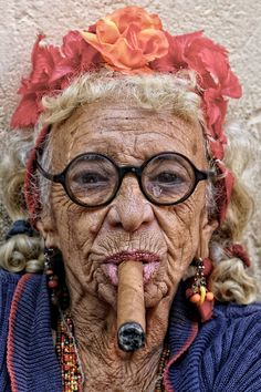 """No dear, really! The femininity of the fake flower garland totally balances out the extreme machismo of the honking big stogie, truly it does!"" #people #cigar #odd"