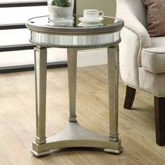 Monarch Specialties Mirror Round End Table. Cheaper at Wayfair. $196. Deciding between the two.