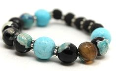 faceted blue fire agates, black lava, blue sponge coral and Bali silver stretch bangle bracelet