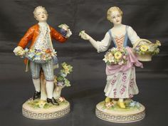 Dresden pair of matching boy and girl figurines with flowers