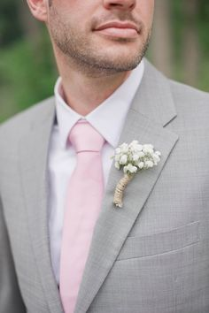 pink tie and baby's breath boutonniere