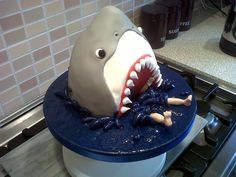 Shark Cake As requested by my 4 year old for his birthday I had a go at making the shark cake from Debbie Brown's book 'gorgeous. Shark Cake, Dinosaur Cake, Debbie Brown, Shark Birthday Cakes, Nautical Cake, Beach Cakes, Pastry Art, Unique Cakes, Fancy Cakes