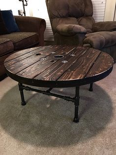 "Here's a coffee table I made from a recycled wood spool, the base is made from 3/4 & 1/2"" black iron pipe, glass top is an available option. $320 with glass top $425"