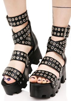 Current Mood Rivet Head Platforms will have yew ready to stomp out yer enemiez, bb! These sandals feature a thikk treaded black sole, zipper closure up the back, and thikk black grommet straps criss-crossin' over yer foot.