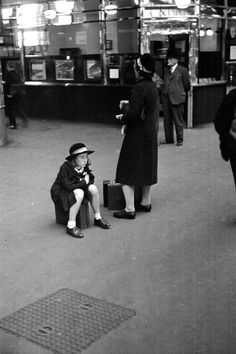 """ A schoolgirl sitting on her suitcase on the concourse of a railway station in London. 1938 Original Publication: Picture Post - 13 - And Again: Back To School © Kurt Hutton/Picture. Private School, Public School, Magazine Pictures, Only Clothing, The Blitz, Kingdom Of Great Britain, Bw Photography, Famous Photographers, Going Back To School"
