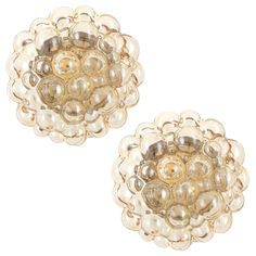 Pair of Limburg Flush Lights Amber Tone Bubble Glass by Helena Tynell, 1960s | From a unique collection of antique and modern wall lights and sconces at https://www.1stdibs.com/furniture/lighting/sconces-wall-lights/