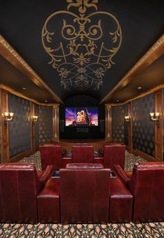 Elegant, tiered Home Theater with stenciled ceiling