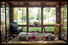 Oh my.  I would love to have a porch/sun room like this... perfect for hot summer evenings.