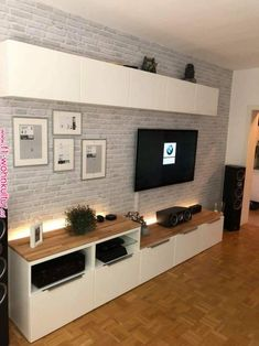 Pin von Léa Sebag auf Intérieur – Eva Kudziova - Home Accents living room Tv Wall Design, Design Case, Scandinavian Minimalist Living Room, Ikea Living Room, Wall Cabinets Living Room, Living Rooms, Small Apartments, Apartment Living, Home And Living