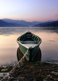 boat by liingaard  afternoon boat fewa tal lake lonely nepal pokhara quiet travel water liingaard