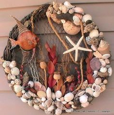 Going Coastal (an Etsy wreath). Seems like a net is wrapped around a twig or grapevine wreath, and then shells, etc., glued on it and tucked into it.