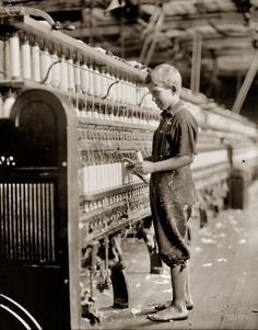 "September 1910. North Pownal, Vermont. ""Clarence Wool, 11 years. Spinner in North Pownal Cotton Mill. Worked only during vacation."" Photograph (original glass negative) and caption by Lewis Wickes Hine."