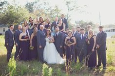 Almost perfect, dark grey suits with navy blue dresses (they're purple in the picture)