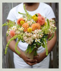 love the base for the bouquet, maybe with different focal flowers that are lighter, peach or coral colored