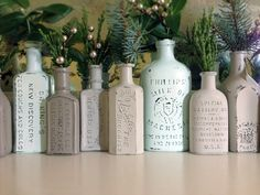 Lovely painted and distressed bottles from Cathe Holden. She can source and afford vintage apothecary vials, but if you can't, don't fret; I've managed the effect with Martellini's apple juice bottles. Also, I've gotten clearer lettering effects by spraypainting the inside of the bottle black. When you sandpaper the outside paint away, the letters show through more darkly and dramatically.