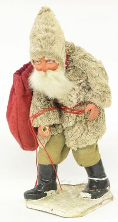 Great 1910 Santa in mohair coat with felt pack on his back.