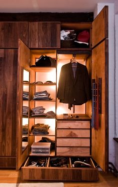 MAN closet made simple. I'm not sure if I like this. Looks like the closet from a luxury suite on a cruise ship.