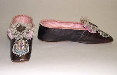 Slippers 1863, British, Made of leather, with silver metal lace, silk and bead applique. From the Met.