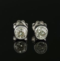 Art Deco 1.80 Ct wheighted old cut diamond stud earrings by hawkantiques on Etsy https://www.etsy.com/listing/471252277/art-deco-180-ct-wheighted-old-cut