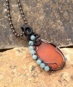 Unique one of a kind orange sea glass pendant wrapped by silverlv, $68.00