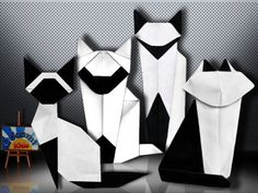 Top Cat / Don Gato y su Pandilla  Folder and Photo: Origami-kids  From left to right:  1) Origami Siamese Cat of Makoto Yamaguchi  2) Orgami Kitty Cat by Martha Mitchen  3) Origami Siamese Cat by Martha Mitchen  4) Origami Dusseldorf cat by Robert Lang   http://origami-blog.origami-kids.com/top-cat-don-gato-y-su-pandilla.htm
