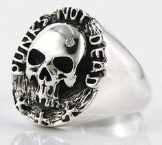 """""""Punk not Dead"""" Sterling silver diamond skull ring - polished solid 925 sterling silver- Size of skull: x Inches.- Stamp 925 trademark inside the band. Mens Skull Rings, Silver Skull Ring, Mens Silver Rings, Silver Man, Sterling Silver Rings, Bullet Jewelry, Geek Jewelry, Skull Jewelry, Gothic Jewelry"""