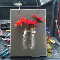 Mason jar decor. something like this would be so cute on both sides of the tv