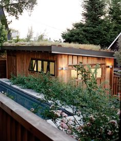 This renovated 1930s cottage features a garden on top of the external garage.
