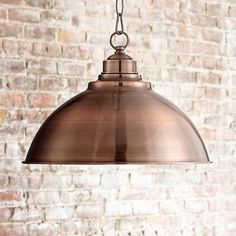 Copper pendants will go with your beige sofas