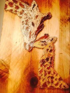 Mother and baby giraffe string art, beautiful! #stringart #ad #wallart #walldecor #homedecor #nursery #nurserydecor #giftideas #mothersday #mothersdaygift #girafffe #animalart #animals #african